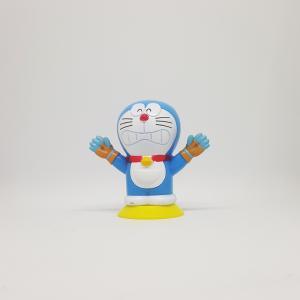 Doraemon-bao-boi-gang-tay-chuot-chui.jpg